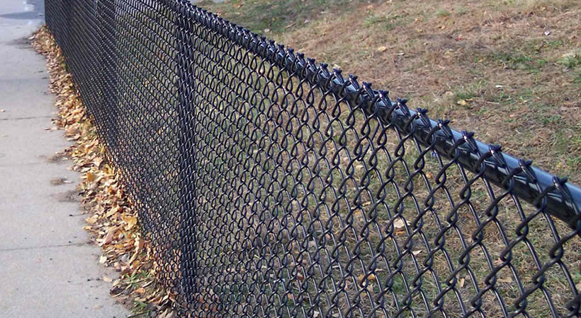 Black vinyl chain link fence for road protection.