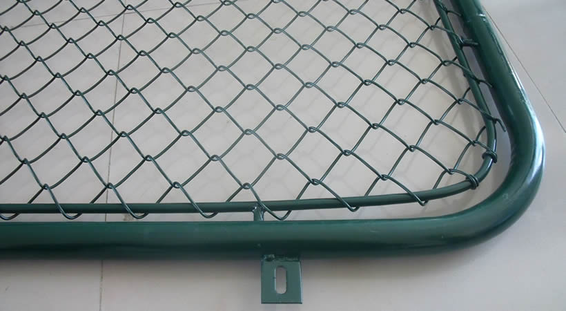 Green PVC chain wire fence mounted on green steel tube frame.