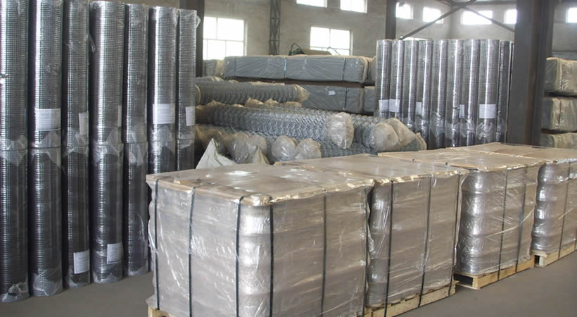 Chain link mesh rolls packaged on pallet.