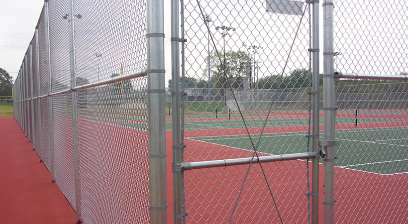 Galvanised chain link fence and gate for basketball court.